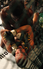 Washington of Guam punches Emil of Sweden during their Pacific Rim Organised Fighting MMA match in Taiwan