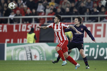 Arsenal's Rosicky challenges Olympiakos' Greco during their Champions League soccer match in Athens