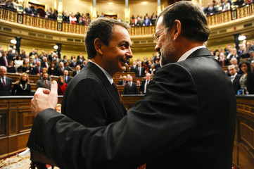 Spain's People's Party leader Rajoy is congratulated by outgoing PM Rodriguez Zapatero after being elected as Spain's new Prime Minister at Parliament in Madrid