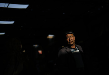 An ethnic Uighur man walks along a market in downtown Turpan, Xinjiang province
