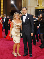 Leonardo DiCaprio and his mother Irmelin DiCaprio arrive on the red carpet at the 86th Academy Awards in Hollywood