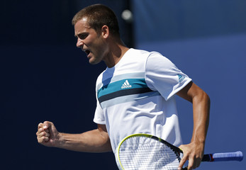 Youzhny of Russia celebrates a point against Muller of Luxembourg during their men's singles match at the U.S. Open tennis tournament in New York