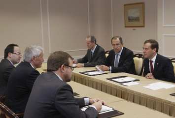 """Russia's President Medvedev, Secretary-General of the European Commission Jagland and Russia's Foreign Minister Lavrov attend a meeting, part of the """"Euro-Atlantic Security Community: Myth or Reality?"""" conference, in Moscow"""