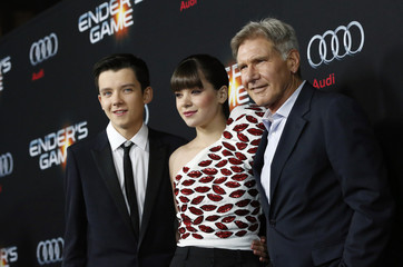 """Butterfield, Steinfeld and Ford pose at the premiere of """"Ender's Game"""" at the TCL Chinese theatre in Hollywood"""