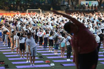 Chinese high school students practise yoga at a schoolyard in Chongqing