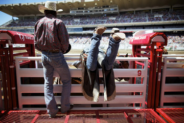 Novice saddle bronc rider Resch gets the horse Xtra Marbles ready for his ride at the Calgary Stampede rodeo in Calgary