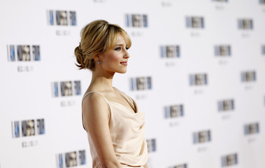 """Agron poses at the premiere of """"I Am Number Four"""" at the Village theatre in Los Angeles"""