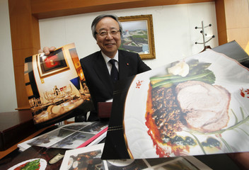 Japanese spice maker Ajinomoto Co President and CEO Masatoshi Ito shows his pictures at his office at the company headquarters in Tokyo