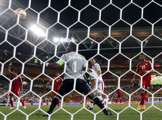 Iran's Reza Ghoochannejhad heads the ball to score a goal against UAE during their Asian Cup Group C soccer match at the Brisbane Stadium in Brisbane
