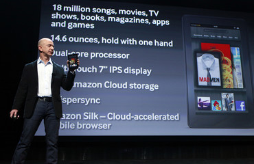 Jeff Bezos holds up the new Kindle Fire as he speaks at a news conference during the launch of Amazon's new tablets in New York