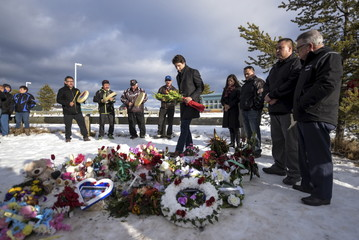 Canada's Prime Minister Justin Trudeau lays a wreath at a memorial during a visit to the town of La Loche