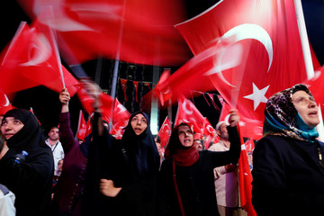 Supporters of Turkish President Tayyip Erdogan wave Turkish flags during a pro-government demonstration at Taksim square in central Istanbul, Turkey
