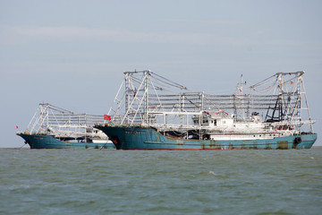 Boat 11202 cruises past in the city of Dongfang on the western side of China's island province of Hainan