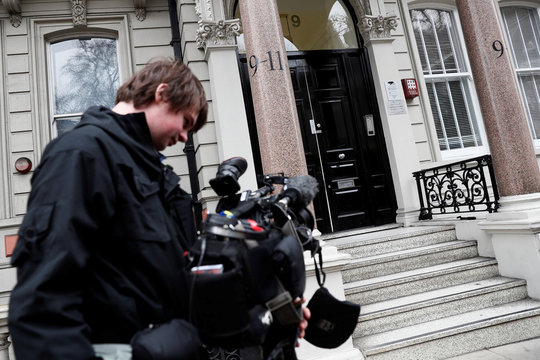 A camera man stands outside the building housing the offices of Orbis Business Intelligence where former British intelligence officer Steele works, in central London