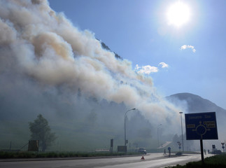 A forest fire is seen next to the southwestern village of Visp