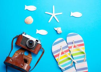 camera, seashells, starfish, sandals and toys