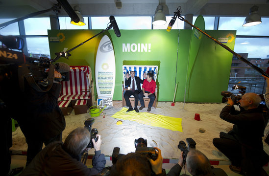 Green Party co-leader Oezdemir and Schleswig-Holstein's regional parliamentary faction leader Habeck pose in beach chair in Kiel