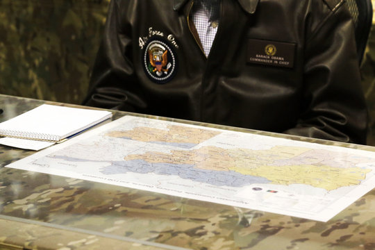 A map of Afghanistan sits in front of Obama during a military briefing at Bagram Air Base in Kabul