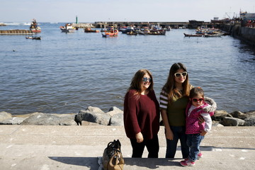 People pose for a picture at the Terminal Pesquero (fisherman's harbor) in Antofagasta