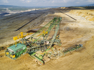 Aerial view of bucket wheel excavator in Turow coal mine, Poland, Europe.