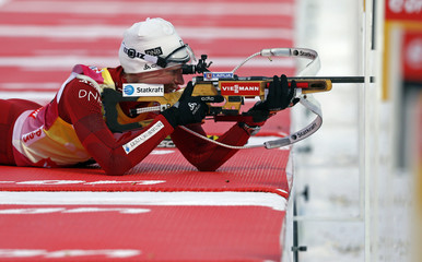 Berger of Norway shoots her rifle as she competes in the women's 7.5 km sprint during the International Biathlon Union World Championships in Nove Mesto