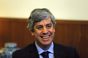 Portugal's Finance Minister Mario Centeno smiles during an interview with Reuters in Lisbon