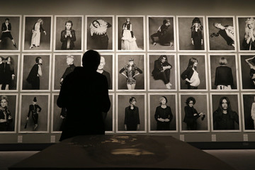 """Portraits are displayed during the opening of a photo exhibition entitled """"Little Black Jacket"""" by Chanel's creative director Lagerfeld in Paris"""