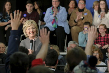 Audience members raise their hands to ask U.S. Democratic presidential candidate Hillary Clinton a question at a campaign town hall meeting in Dover