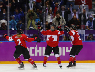 Canada's Poulin celebrates her gold medal winning goal against Team USA with teammates Agosta-Marciano and Wickenheiser in overtime in the women's ice hockey gold medal game at the 2014 Sochi Winter Olympic Games