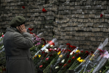 A woman mourns before a makeshift memorial in Kiev's Independence Square