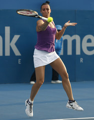 Pennetta hits a return against Li during the Sydney International tennis tournament