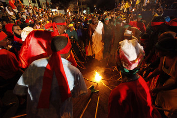 Locals perform during the re-enactment of the 1881 Kambule riots on the Piccadilly Greens, east Port-of-Spain