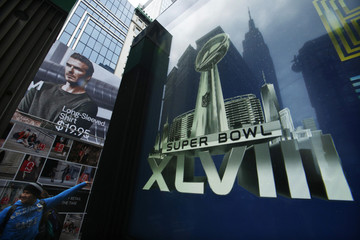A man walks past a Super Bowl icon as preparations continue for Super Bowl XLVIII in New York