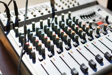 professional music mixer, macro photo music remote control, professional sound. Technical progress in music. Film texture Unfocused