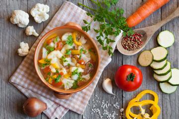 Vegetable soup on dark wood