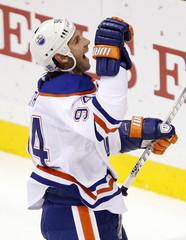 Edmonton Oilers' Smyth celebrates his goal against Minnesota Wild's Backstrom during their NHL hockey game in St. Paul