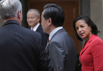 U.S. National Security Adviser Susan Rice, Chinese Foreign Minister Wang Yi and U.S. Ambassador to China Max Baucus