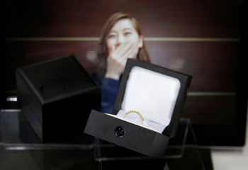 Package design company Sankyo's engagement ring boxes equipped with spy-cams are displayed at the International Jewellery Tokyo trade show in Tokyo