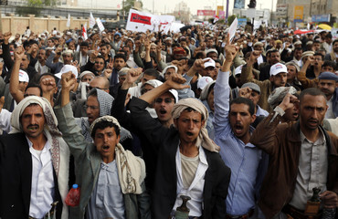 Followers of the Shi'ite Houthi movement march during an anti-government demonstration in Sanaa