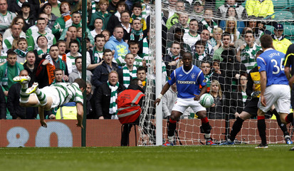 """Celtic's Mulgrew scores against Rangers during their Scottish Premier League """"Old Firm"""" soccer match in Glasgow"""