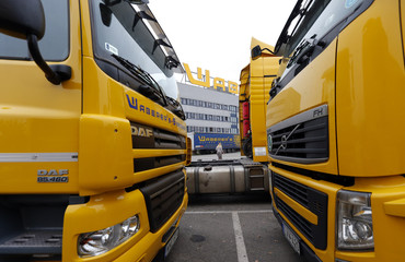 Trucks line up in the parking lot at the main site of Hungarian road haulage firm Waberer's in Budapest