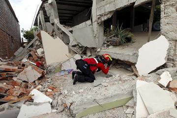 A fireman works after an earthquake struck off Ecuador's Pacific coast, at Tarqui neighborhood in Manta