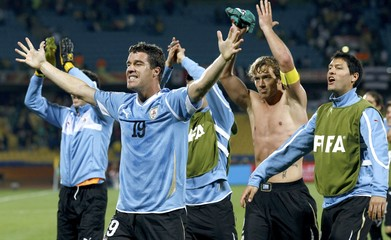 Uruguay's Andres Scotti celebrates with his teammates during a 2010 World Cup Group A soccer match at Royal Bafokeng stadium in Rustenburg