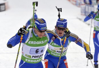 Sweden's Bergman and Lindstrom ski during the mixed 2 x 6 + 2 x 7.5 km relay Biathlon World Cup event in Pokljuka