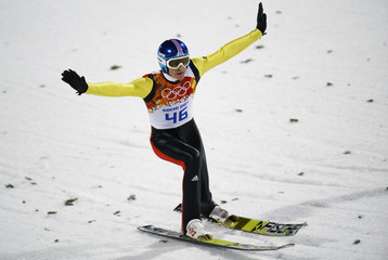 Freund reacts after his jump during the first round of the men's ski jumping large hill individual final of the Sochi 2014 Winter Olympic Game