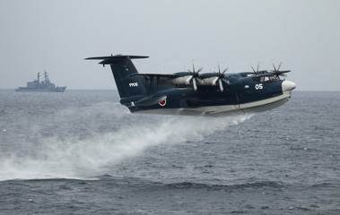 A Japanese Maritime Self-Defense Force (MSDF) seaplane takes off during a naval fleet review at Sagami Bay, off Yokosuka, south of Tokyo