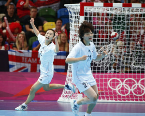 South Korea's Woo Sun-hee celebrates a goal against Russia in their women's handball quarterfinals match at the Copper Box venue during the London 2012 Olympic Games