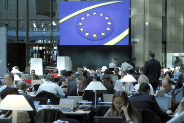 Journalists work in the main media hall at the EU summit in Brussels