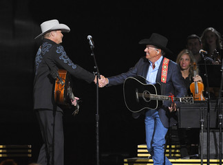Alan Jackson and George Strait perform during the 50th Annual Country Music Association Awards in Nashville