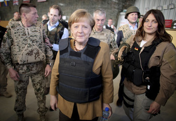 German Chancellor Merkel sports a flak jacket after she arrived to Mazar-i-Sharif to meet German army Bundeswehr soldiers